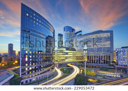 Paris. Image of office buildings in modern part of Paris during sunset. - stock photo