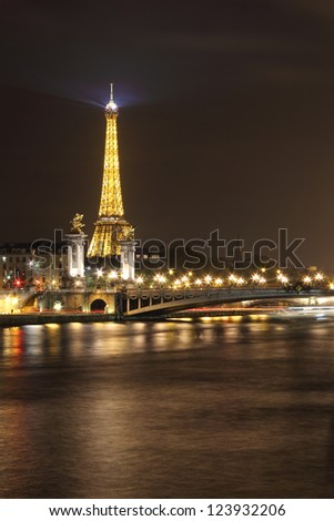 PARIS - OCTOBER 14: Alexander III bridge illuminated and wonderful Eiffel tower on October 14, 2012 in Paris, France.  In 2011 7.1 million people ascended  the tower.