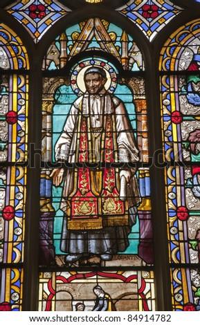 Paris - windowpane from Saint Germain-l'Auxerrois gothic church - saint Vincent de Paul - stock photo