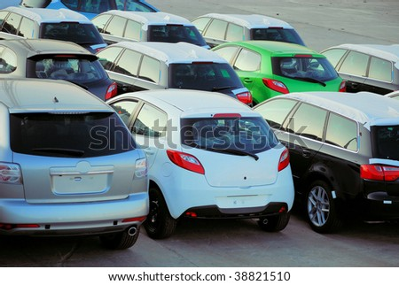 parking and transportation of new cars from factory - stock photo