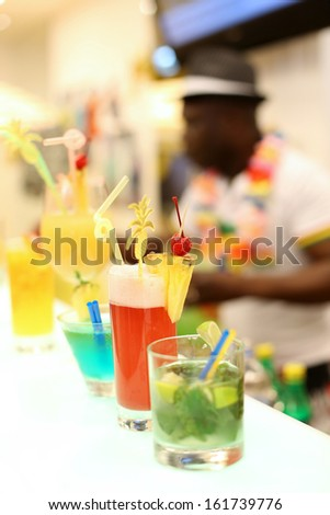 Party event concept. Professional barman prepare cocktail drinks.