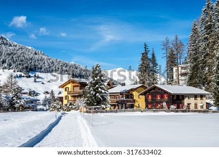 Pass way and wood chalets  over  mountains in Davos, Switzerland. - stock photo