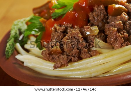pasta with  beef ,vegetable  tomato sauce  on wooden table