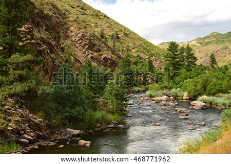 peaceful scene along the south platte river in waterton canyon, littleton,  colorado