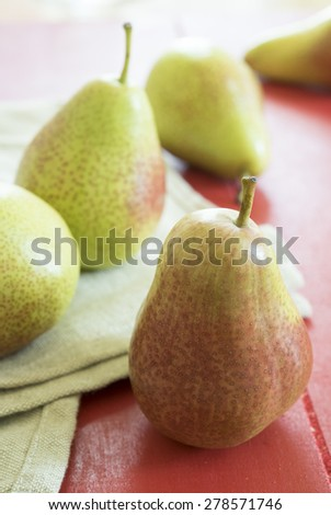 pear in a red color wood  background