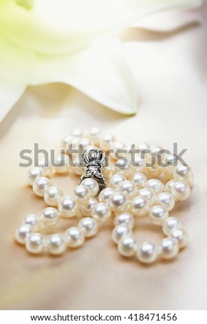 pearl jewerly on white table