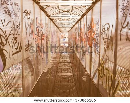 Pedestrian bridge with graffiti picture vintage - stock photo
