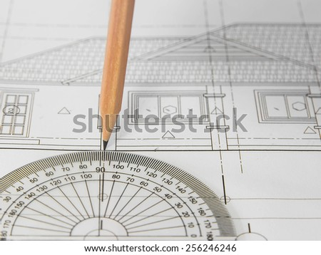 Pencil over Blurred architectural blueprint of office building - stock photo