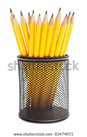 pencils in pencil holders - stock photo