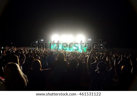 people at concert with bright lights