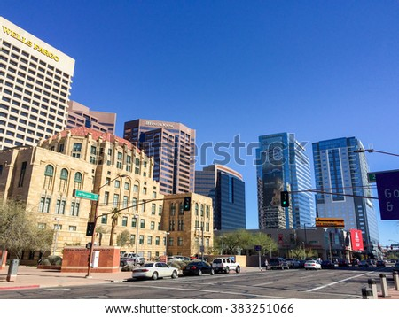 PHOENIX, AZ - FEBRUARY 8, 2016: Bank and financial institution skyscrapers rising above Cesar Chavez Memorial Plaza at Jefferson Street in Phoenix, Arizona