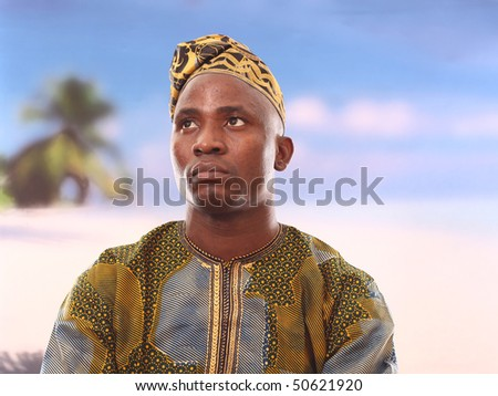 Photograph of an energetic and satisfied man on the beach - stock photo
