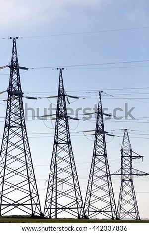 photographed close-up, high-voltage electric poles located in the   countryside