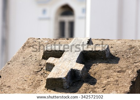 photographed close-up of a cross carved in stone. Entrance to the Orthodox Church - stock photo
