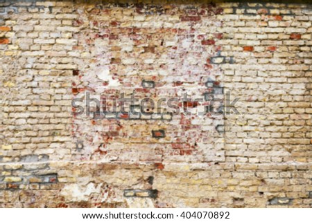 photographed close-up of an old crumbling brick wall of the building, disfocus
