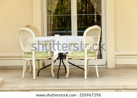 photographed close-up seats, located in a cafe on the street - stock photo
