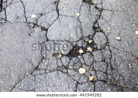 photographed close up the broken pavement on the old highway, defocus - stock photo