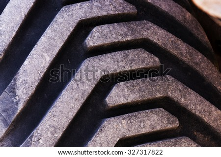 photographed close-up wheels of the tractor  - stock photo