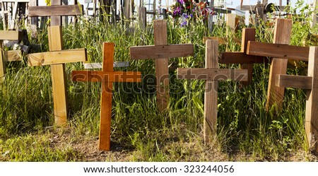 photographed close-up wooden crosses on the Hill of Crosses - stock photo