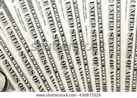 photographed new American dollars, piled in a heap. close-up - stock photo