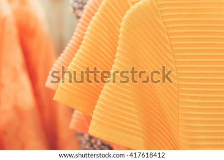 photos with a bunch of things on hangers with clothes mazig perfect photo advertising banner or poster with clothes , summer dress shirts summer tops, store things - stock photo
