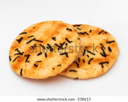 2 pieces of brownish Japanese rice biscuit with seaweed - stock photo