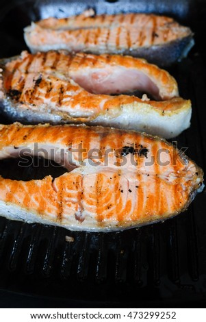 3 pieces of salmon roasted close up on home electronic grill plate tasty diet fish meal