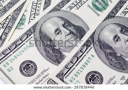 pile of dollars in the United States of America as a background