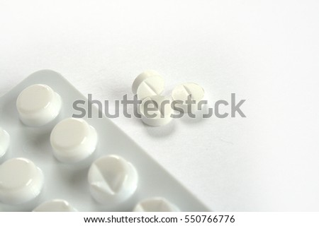 3 pills and blister on white
