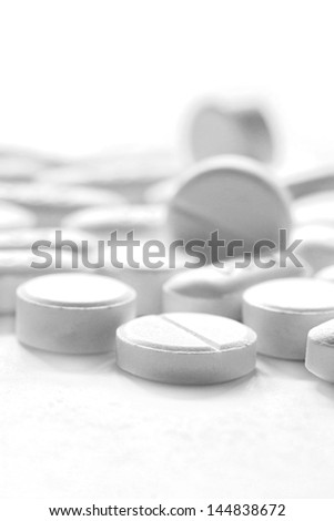 pills, white round medicine tablets isolated on white background, white round drug pills for help headache temperature and pain. healthy and hospital