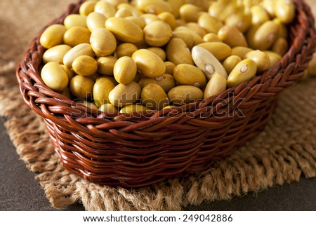 Pinto Beans in wooden bowl - stock photo