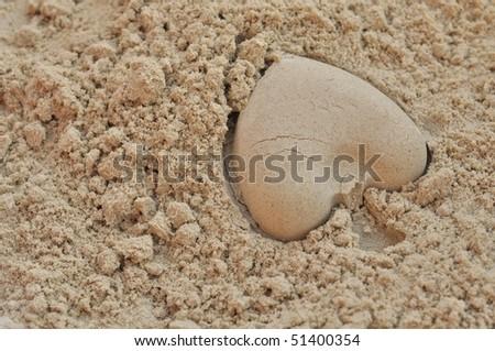Plastic sandbox child toy on summer beach sand - stock photo