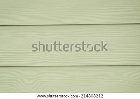plastic siding wood texture background of a house wall - stock photo