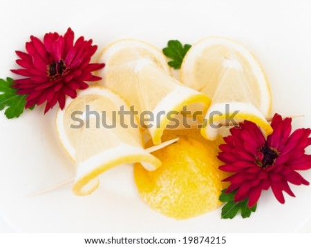 plate with lemon and flowers on the plate