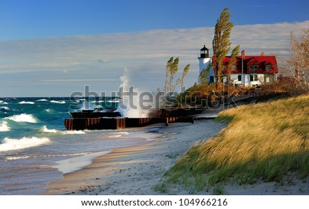 Point Betsie Lighthouse Frankfort, Michigan USA Gale force wind and waves crashing . Sunrise - stock photo