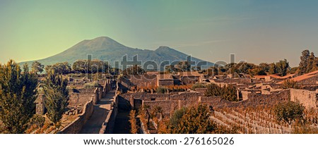 Pompeii was destroyed, and completely buried, during a long catastrophic eruption of the volcano Mount Vesuvius spanning two days in AD 79. - stock photo