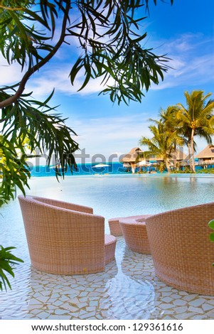 pool and chairs for rest - stock photo