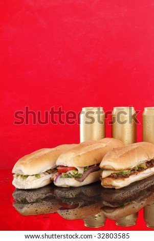 3 popular sandwiches and golden cold cans - Chicken Caesar, Deli giant and Philly - stock photo