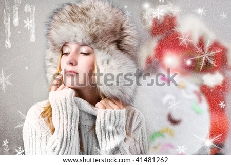 Portrait beautiful girl wearing white sweater and fur hat - stock photo