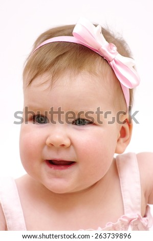 Portrait of a baby girl smiling  - stock photo
