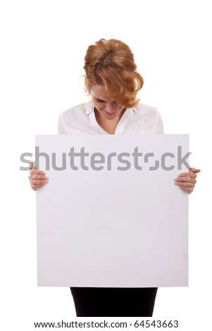 Portrait of a beautiful business woman holding a blank billboard, looking out from behind it. beautiful woman and blank sign - stock photo