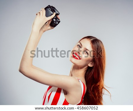 portrait of a beautiful girl with a camera