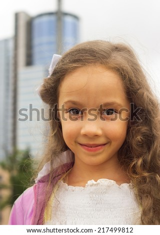 Portrait of a beautiful little girl close-up