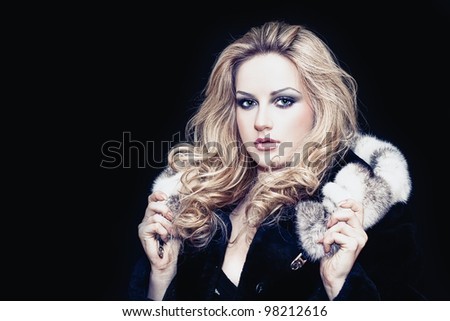 Portrait of a beautiful young woman in fur - stock photo