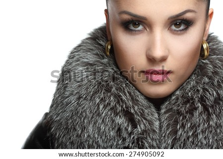 portrait of a beautiful young woman in furs. beautiful makeup, stylish hairstyle and bright emotions - stock photo