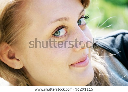 portrait of a beautiful young woman on the nature
