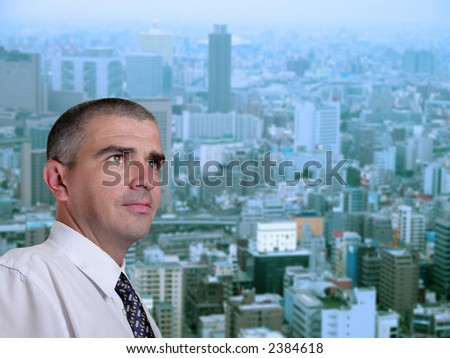 Portrait of a business manager in his office near the window in a metropolis. - stock photo