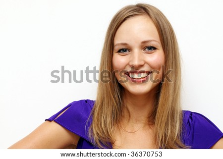 portrait of a happy young woman smiling isolated on white background