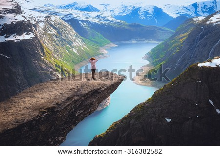 Portrait of a long-range plan for the girls in the language of the troll in the mountains of Norway, the feeling of complete freedom - stock photo
