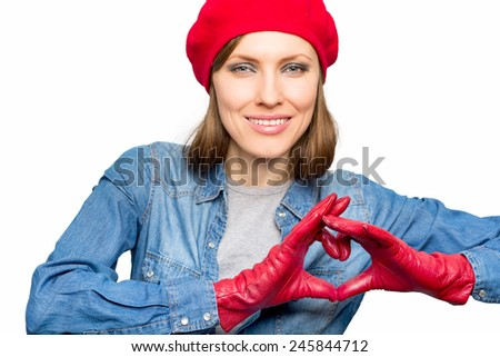 Portrait of a lovely woman making heart of fingers, focus on fingers - stock photo